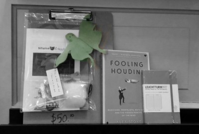 """Fooling Houdini,"" Luna Moth, and Journal on a shelf"